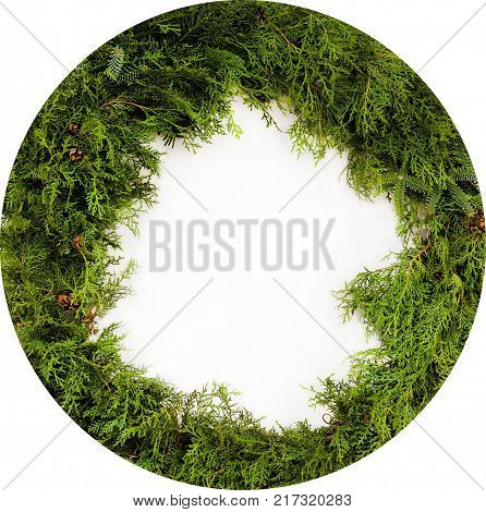 Christmas wreath isolated on white. Christmas wreath made from lot of fir twigs on white background. Green round Christmas wreath isolated on white background.