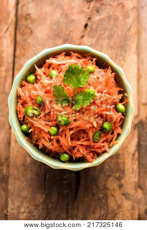 Carrot raita / Gajar Koshimbir. It a condiment from the Indian subcontinent, made with or without dahi / curd together with raw / cooked vegetables Gajar / Carrot, green, peas, chilli, coriander