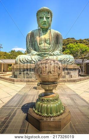 Kotoku-in Temple in Kamakura, Kanto region, Japan. The temple is famous for Great Buddha or Daibutsu, a monumental bronze statue of Amida Buddha, one of the most famous icons of Japan. Vertical shot.