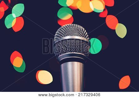 Audio microphone on stage with bokeh light. Music concert or talent show concept with copy space.