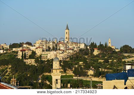Israel Jerusalem view on the Mount of Olives from the old city roofs at sunset