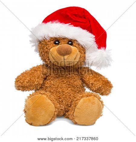 Christmas teddy bear wearing a Santa Claus hat isolated on white background, cut out.