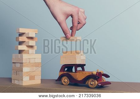 Wooden puzzles load on a retro car