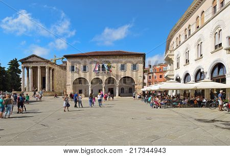 PULA CROATIA - SEPTEMBER 1 2017: The Forum square in Pula; The Forum square is a central square in Pula where main monuments like the Temple of Augustus and the Communal Palace are located.