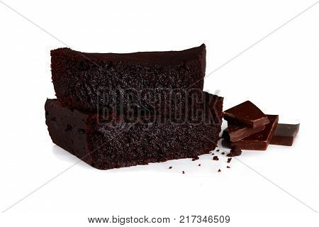 Homemade chocolate brownie and pieces of chocolate baking. isolated on white background