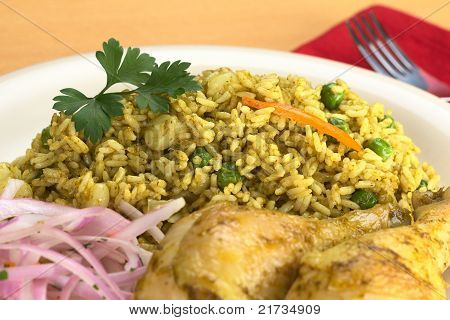Peruvian dish called Arroz con Pollo (Rice with Chicken) which is made of rice peas corn aji (hot pepper) cilantro served with chicken and Salsa Criolla (onion salad) (Selective Focus Focus on the front of the parsley leaf and the front of the rice) poster