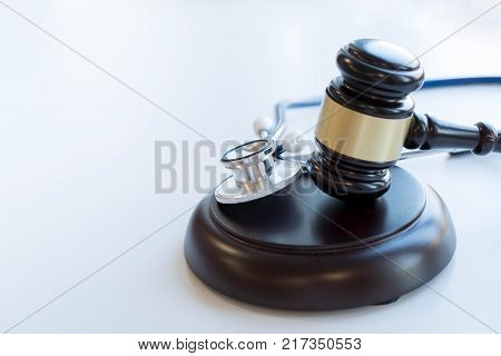 Gavel and stethoscope. medical jurisprudence. legal definition of medical malpractice. attorney. common errors doctors nurses and hospitals make.