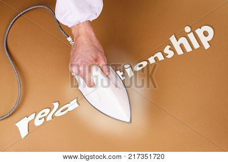 Man iron iron the floor on a brown background. The view from the top. Flat lay