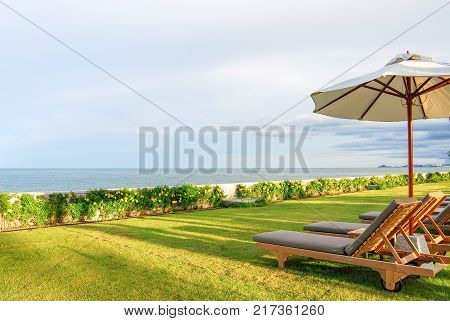 chairs and umbrella on the beach for relax