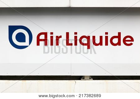 Sassenage, France - June 24, 2017: Air Liquide logo on a wall. Air Liquide is a french multinational company which supplies industrial gases and services to various industries