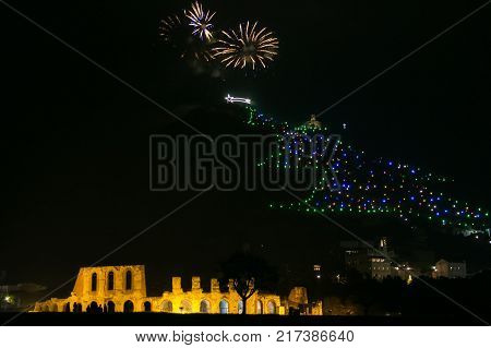 Gubbio city celebrating the New Year or any national event with fantastic multi-colored fireworks