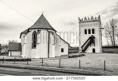 Roman catholic church of St. Anna with renaissance bell tower Strazky Slovak republic. Religious architecture. Travel destination. Black and white photo.