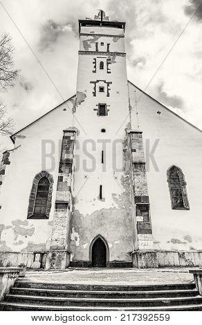 Basilica of the Holy Cross in Kezmarok city Slovak republic. Religious architecture. Travel destination. Black and white photo.