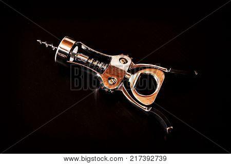 Metallic corkscrew on the dark background. Objekt scene.