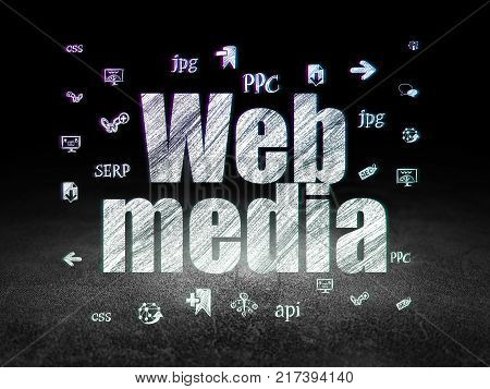 Web design concept: Glowing text Web Media,  Hand Drawn Site Development Icons in grunge dark room with Dirty Floor, black background