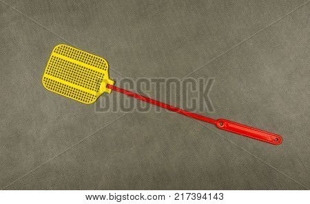Fly-killing device - typical flyswatter. Home plastic flies to kill.