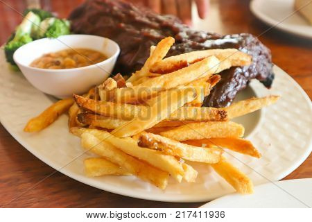 pork rib or pork steak with French fries
