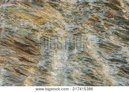 Close up of details of abstract natural stone rock cut texture cross section of weathered granite cliff erosion on the top of the mountains at natural park. Copy Space for text.