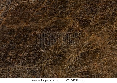 Close up of brown granite texture. High resolution photo.