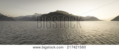 Panorama landscape of the mountain lake Lucerne. Wide lens. A spacious volume. Monocrom
