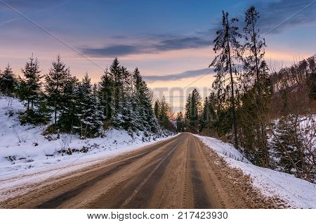 Road Through Winter Forest At Down