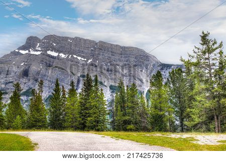 North face of Mt Rundle with some snow as seen from Tunnel Mountain camp ground in Banff National Park Alberta Canada.