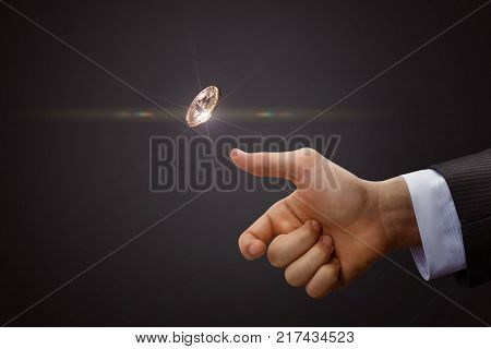 Hand throws a coin. The concept of decision-making.