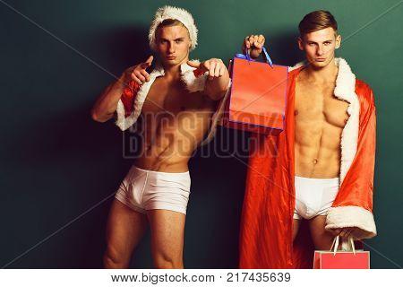 Handsome Macho Santa Twins