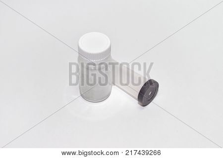 plastic containers: jar for tablets with screw cap and test tube with black lid with hole