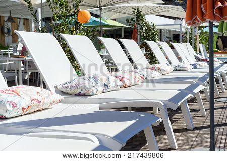 terrace in cafe on the beach with daybed and umbrellas