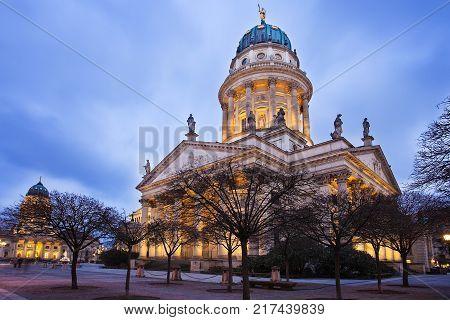 New Church, Deutscher Dom or German Cathedral, on Gendarmenmarkt, with the monument of Friedrich Schiller in the foreground. Berlin, Germany