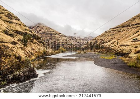 Grand Ronde River Flowing through Foggy Hills in the Pacific Northwest