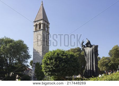 SPLIT, CROATIA - AUGUST 11 2017: Gregory on Nin statue and bell tower in Split