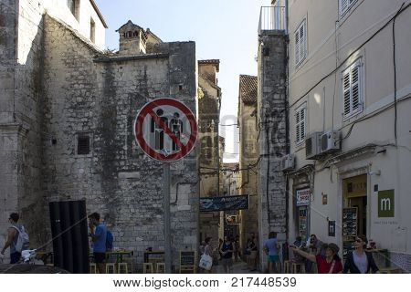 SPLIT, CROATIA - AUGUST 11 2017: Very strange road sign in Split old city with the prohibition of wearing swimsuit