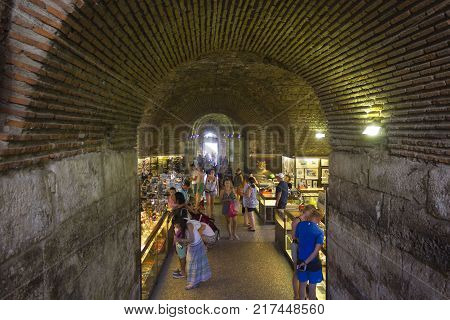 SPLIT, CROATIA - AUGUST 11 2017: Marketplace in the subterranean of Diocletian Palace in Split with people around