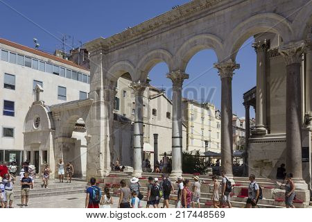 SPLIT, CROATIA - AUGUST 11 2017: People around the peristyle of Diocletian Palace in Split