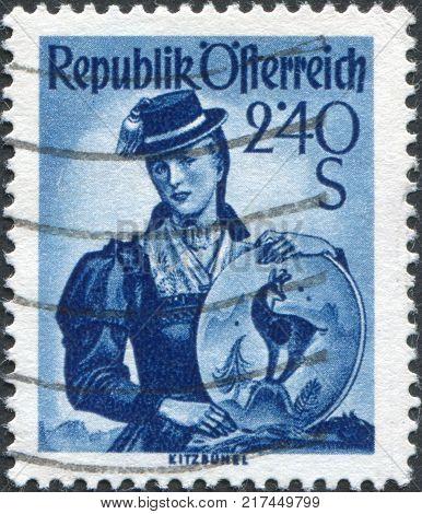 AUSTRIA - CIRCA 1951: A stamp printed in Austria shows a woman in national dress Tyrol Kitzbuhel circa 1951