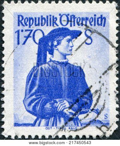 AUSTRIA - CIRCA 1950: A stamp printed in Austria shows a woman in national dress East Tyrol Kals circa 1950