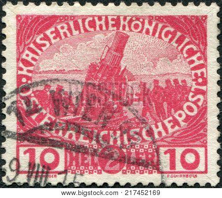 AUSTRIA - CIRCA 1915: A stamp printed in Austria shows the artillery gun Skoda Moerser (Skoda 30.5 cm Moerser M.11) circa 1915