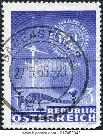 AUSTRIA - CIRCA 1965: A stamp printed in Austria shows the ITU Emblem Telegraph Key and TV Antenna circa 1965