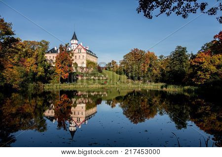 Renaissance castle Radun near Opava city mirrored in a lake in autumn season