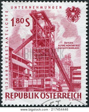 AUSTRIA - CIRCA 1961: A stamp printed in Austria devoted to 15th anniversary of nationalized industry shows a montage Iron blast furnace circa 1961