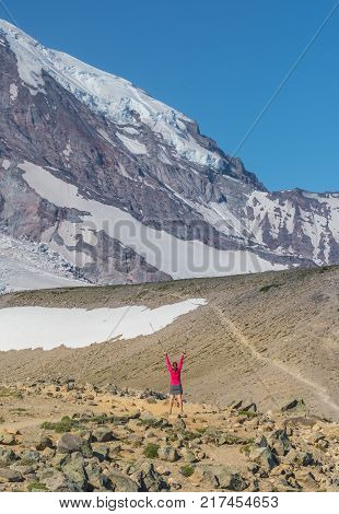 Female Hiker Celebrates a Majestic View of Mount Rainier