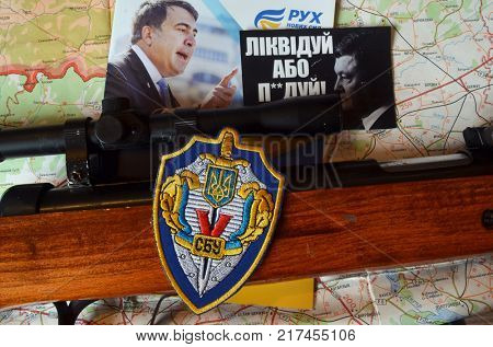 ILLUSTRATIVE EDITORIAL.Chevron of Ukrainian pro-american Security Service of Ukraine, the SBU.Back: Political program Mikhail Saakashvili.Sticker Pork - go away (UKR). Kiev,Ukraine December 7,2017
