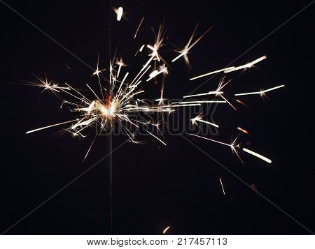 New year party sparkler on black background.Bengal fire