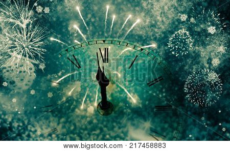 new Year's at midnight - clock at twelve o'clock with holiday lights and fireworks