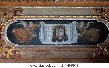 VUKOVOJ, CROATIA - OCTOBER 08: Veil of veronica altarpiece on the main altar in the chapel of St. Wolfgang in Vukovoj, Croatia on October 08, 2016.