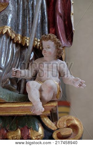 VUKOVOJ, CROATIA - OCTOBER 08: Angel on the main altar in the chapel of St. Wolfgang in Vukovoj, Croatia on October 08, 2016.