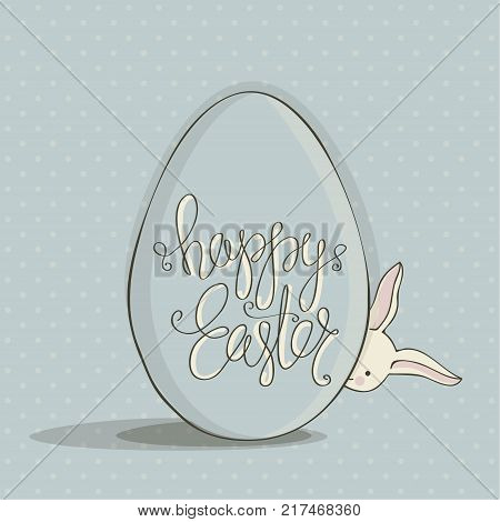 Cover for greeting cards to day happy Easter.Shows a large Easter egg blue color with the phrase happy Easter on it.Easter Bunny with egg. Blue background with polka dots.