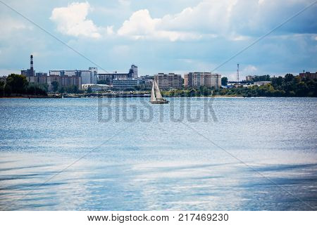 Berdsk Berdsk Gulf the river BerdNovosibirsk oblast Siberia Russia - August 19 2017: yacht in the Gulf of Berdsk in the background the city of Berdsk